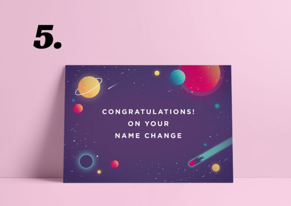 """Re-mark card saying """"Congratulations! On Your name change"""". The background is pink. The card is purple surrounded by planets and comets. In the middle is the text."""